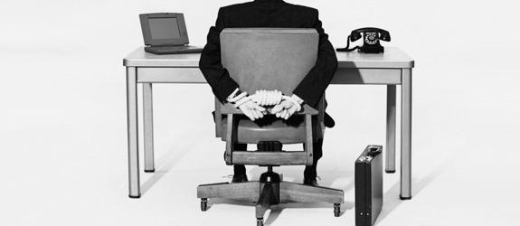 corporate-america-businessman-tied-to-desk_pan_13595